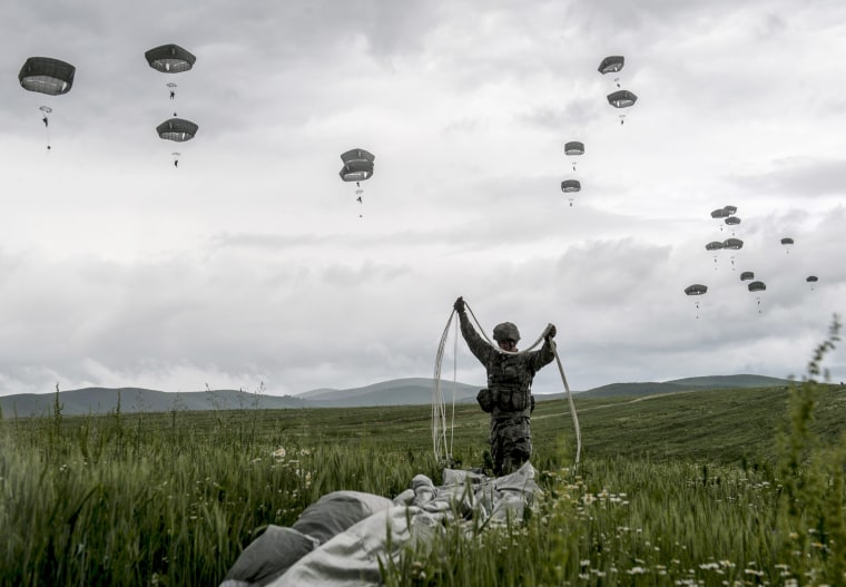 A US para-trooper of the Army's 4th 25 Infantry Brigade Combat Team, part of the NATO-led peacekeeping mission in Kosovo (KFOR) packs his parachute during a military drill near the village of Ramjan on May 27, 2015. (Photo by Armend imani/AFP/Getty)