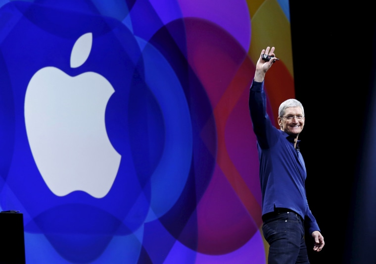 Apple CEO Tim Cook waves as he arrives on stage to deliver his keynote address at the Worldwide Developers Conference in San Francisco, Calif., June 8, 2015. (Photo by Robert Galbraith/Reuters)