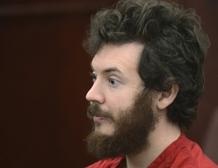 Accused Aurora theater gunman James Holmes listens during his arraignment in Centennial, Colo., March 12, 2013. (Photo by R.J. Sangosti/Reuters)