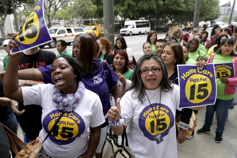 People demonstrate outside City Hall before the Los Angeles City Council approved a proposal to raise the minimum wage to $15.00 per hour in Los Angeles, Calif., June 3, 2015. (Photo by Jonathan Alcorn/Reuters)