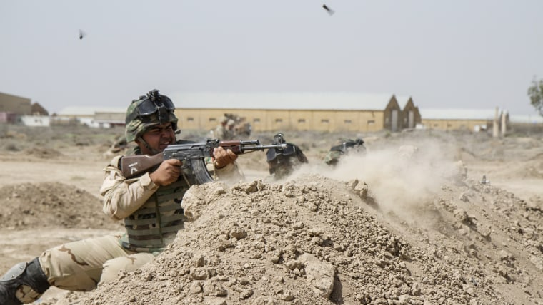 Iraqi soldiers train with members of the U.S. Army 3rd Brigade Combat Team, 82nd Airborne Division, at Camp Taji, Iraq, in this U.S. Army photo released June 2, 2015. (Photo by U.S. Army Sgt. Cody Quinn/Reuters)