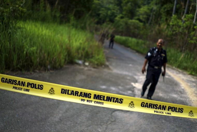 A Malaysian policeman leaves the site of the place where human remains were found, near an abandoned human trafficking camp, in the jungle close to the Thailand border at Bukit Wang Burma in northern Malaysia, May 29, 2015. (Athit Perawongmetha/Reuters)