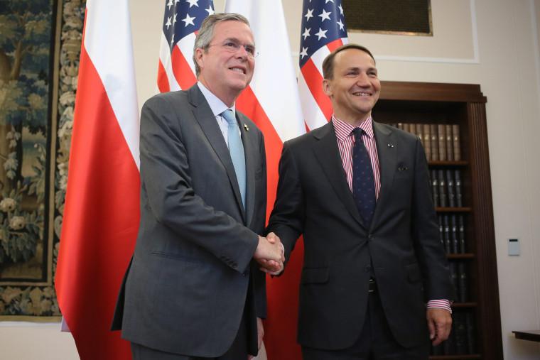 Polish Parliament Speaker Radoslaw Sikorski (R) shakes hand with U.S. politician Jeb Bush (L) before their meeting in Warsaw, Poland, June 11, 2015. (Photo by Laszek Szymanski/EPA)