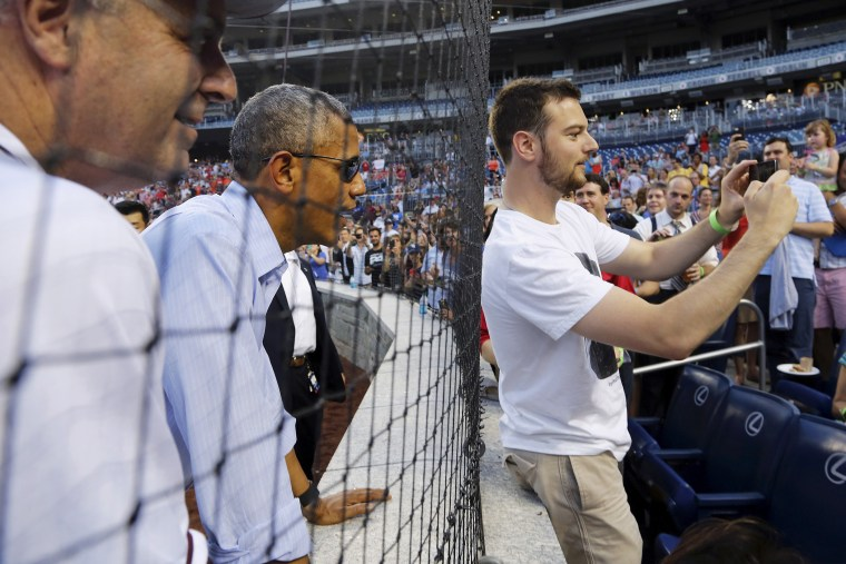 U.S. President Barack Obama interacts with fans at the annual Congressional Baseball Game, pitting Republicans against Democrats for charity, at Nationals Park in Washington June 11, 2015. (Photo by Jonathan Ernst/Reuters)