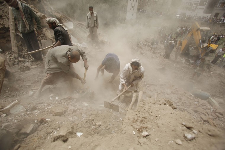 People search for survivors under the rubble of houses destroyed by Saudi airstrikes in the old city of Sanaa, Yemen, June 12, 2015. (Photo by Hani Mohammed/AP)