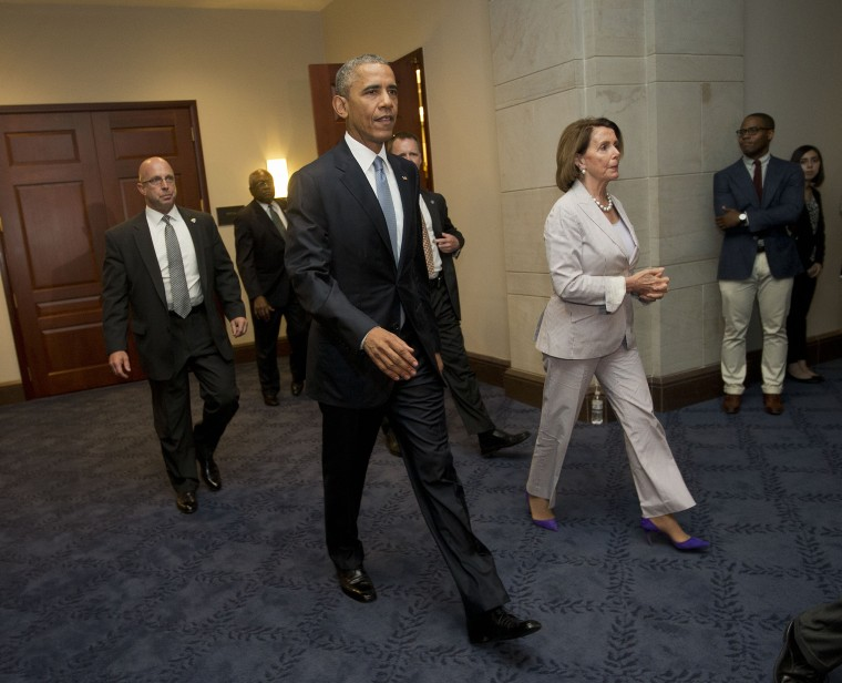 President Barack Obama and House Minority Leader Nancy Pelosi of Calif. leave meeting with House Democrats on Capitol Hill in Washington, June 12, 2015. (Photo by Pablo Martinez Monsivais/AP)