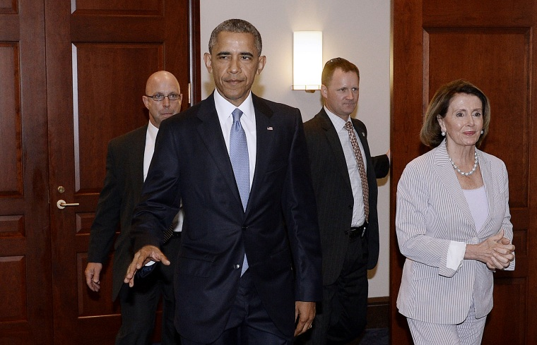 U.S. President Barack Obama and House Minority Leader Nancy Pelosi leave the Gabriel Zimmerman room on Capitol Hill, June 12, 2015 in Washington, D.C. (Photo by Olivier Douliery-Pool/Getty)