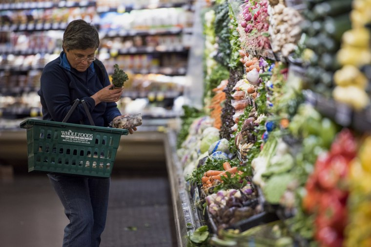 A customer shops for produce at a Whole Foods Market Inc. store in Oakland, Calif. on May 6, 2015.
