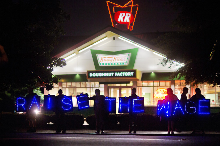 Fast food workers and supporters protest low wages outside a Krispy Kreme store, May 15, 2014, in Atlanta, Ga. (Photo by David Goldman/AP)
