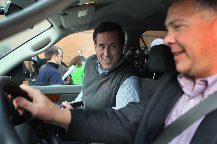 "Republican presidential candidate Rick Santorum gets into his campaign vehicle, a Dodge truck dubbed the ""Chuck Truck"" that is driven by Chuck Laudner on Dec. 31, 2011 in Indianola, Ia. (Photo by Scott Olson/Getty)"