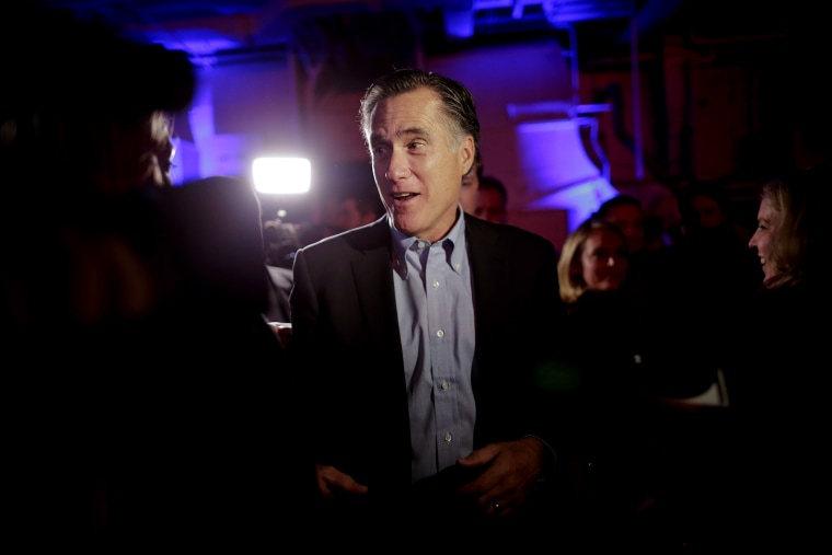 Mitt Romney, the former Republican presidential nominee, talks with people after speaking during the Republican National Committee's winter meeting aboard the USS Midway Museum, Jan. 16, 2015, in San Diego. (Photo by Gregory Bull/AP)