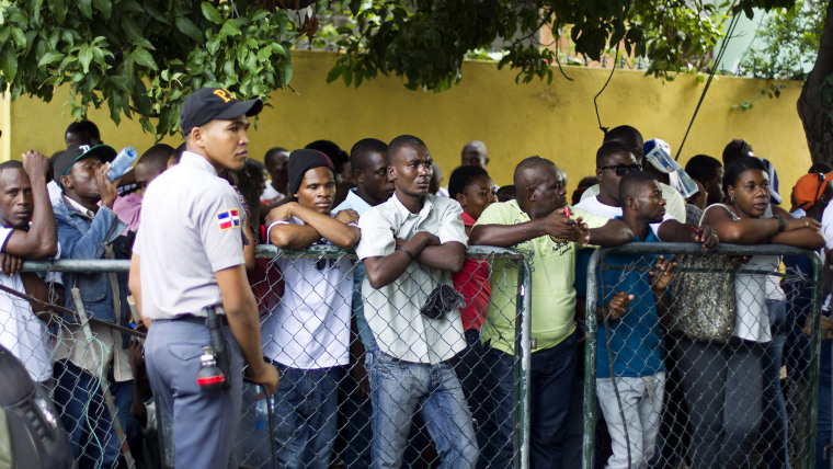 Haitians queue up to legalize their status at the Interior Ministry in Santo Domingo, on June 16, 2015. (Photo by Erika Santelices/AFP/Getty)