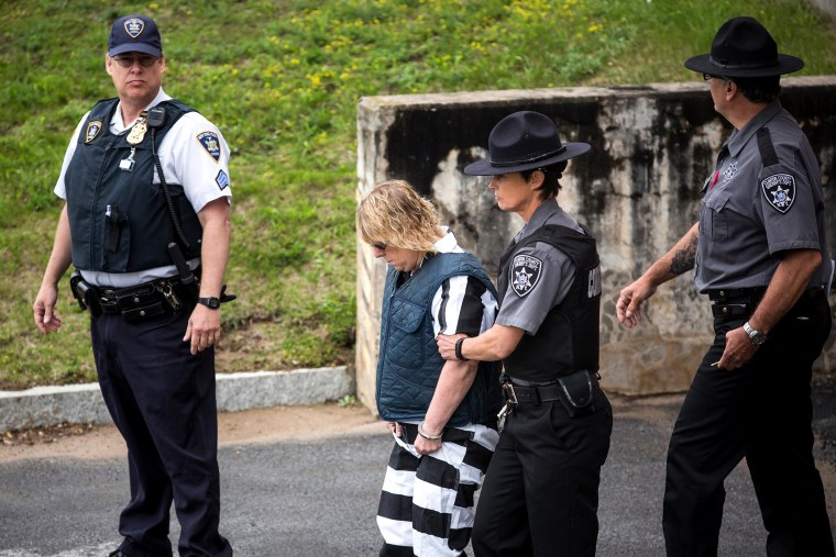 Joyce Mitchell, a prison worker who allegedly helped two convicts escape from prison, is lead from Plattsburgh Ciy Court after a hearing on June 15, 2015 in Plattsburgh, N.Y. (Photo by Andrew Burton/Getty)