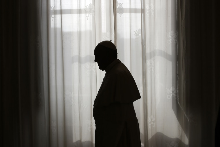 Pope Francis is silhouetted at the Vatican on Oct. 25, 2013. (Photo by Max Rossi/AFP/Getty)