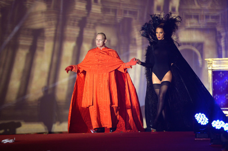 Ben Becker (L) and Carmen Carrera (R) are seen on stage during the Lifeball 2014 at City Hall on May 31, 2014 in Vienna, Austria. (Photo by Thomas Lohnes/Getty)