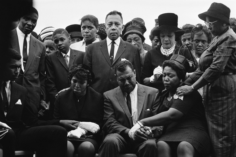 The family of Carole Robertson, a 14-year-old African American girl killed in a church bombing, attend graveside services for her, Sept. 17, 1963, Birmingham, Ala. (Photo by Horace Cort/AP)