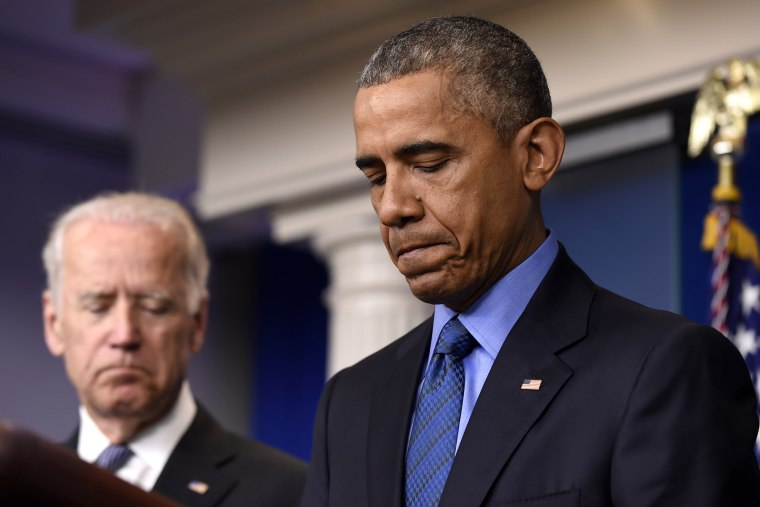 President Barack Obama, accompanied by Vice President Joe Biden, pauses while speaking in the Brady Press Briefing Room of the White House in Washington, D.C., June 18, 2015, on the church shooting in Charleston, S.C. (Photo by Susan Walsh/AP)