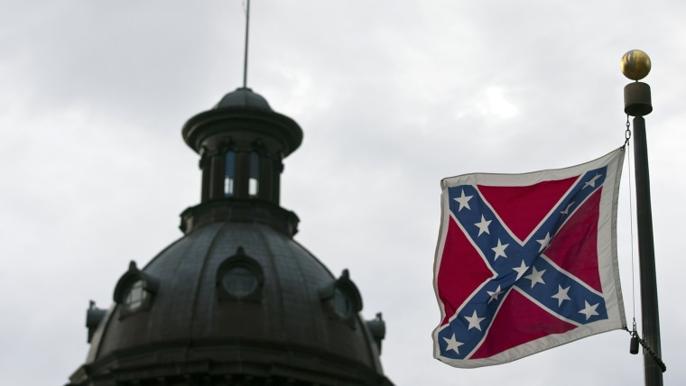 A Confederate flag flies outside the South Carolina State House in Columbia, S.C., Jan. 17, 2012. (Photo by Chris Keane/Reuters)
