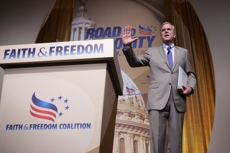 """Republican U.S. presidential hopeful and former Florida Governor Jeb Bush waves after he spoke during the \""""Road to Majority\"""" conference June 19, 2015 in Washington, D.C. (Photo by Alex Wong/Getty)"""