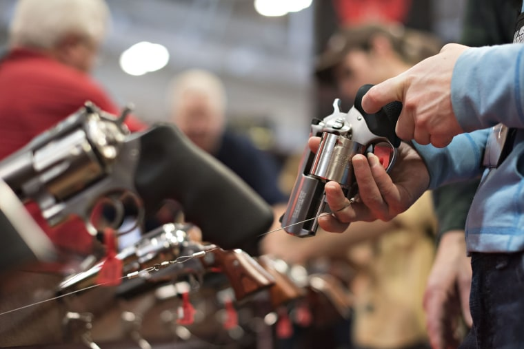 An attendee handles a revolver in the Sturm, Ruger & Co., Inc. booth on the exhibition floor of the 144th National Rifle Association (NRA) Annual Meetings and Exhibits in Nashville, Tenn. on April 11, 2015. (Photo by Daniel Acker/Bloomberg/Getty)