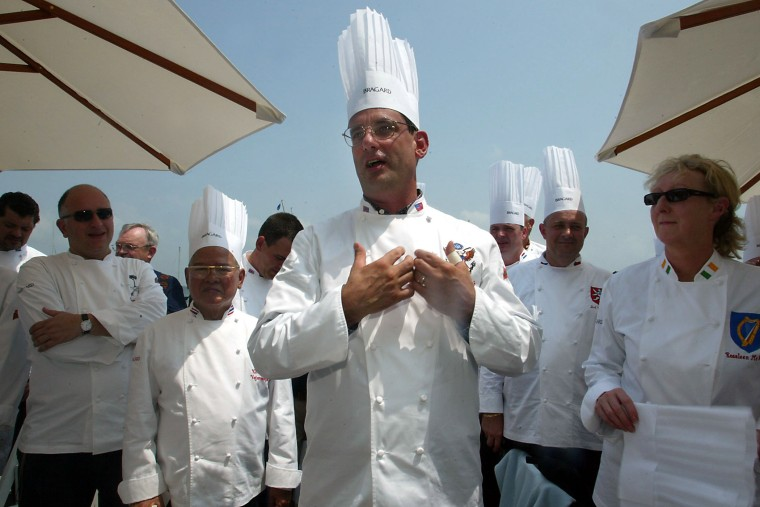 Chef to president George W. Bush , Walter Scheib, greets chefs from around the world at the Chesapeake Bay Maritime Museum in St. Michaels, Md., July 27, 2004. (Photo by Matt Houston/AP)