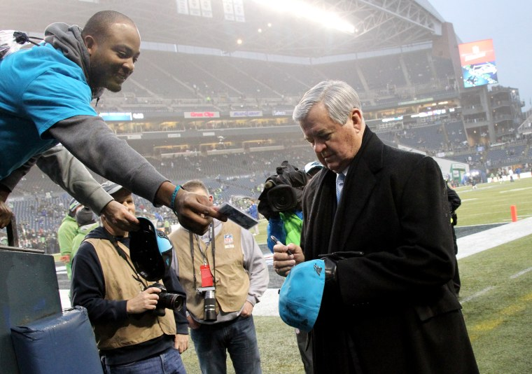 Carolina Panthers owner Jerry Richardson signs an autograph for a fan before an NFL Divisional Playoff game against the Seattle Seahawks on Jan. 10, 2015 at CenturyLink Field. (Photo by Kevin Terrell/AP)