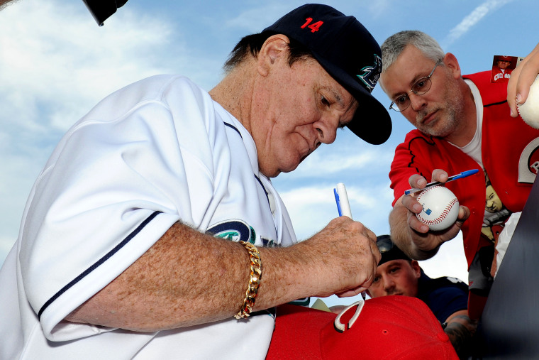 Former Major League Baseball player Pete Rose signs an autograph prior to managing the game for the Bridgeport Bluefish against the Lancaster Barnstormers on June 16, 2014 in Bridgeport, Conn. (Photo by Christopher Pasatieri/Getty)