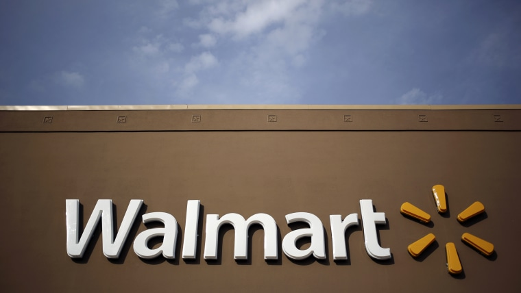 Wal-Mart Stores Inc. signage is displayed outside of a store in Louisville, Ky., May 15, 2015. (Photo by Luke Sharrett/Bloomberg/Getty)
