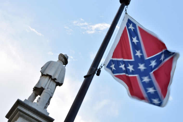 The Confederate flag is seen next to the monument of the victims of the Civil War in Columbia, S.C., on June 20, 2015. (Photo by Mladen Antonov/AFP/Getty)