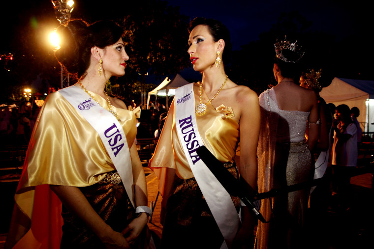 Contestants for Miss Queen International 2014, Transgender beauty pageant Miss Samira Sitara from USA speak with Miss Veronika Svetlova from Russia at the Loy Krathong festival ceremony in Bangkok. (Photo by Piti A Sahakorn/LightRocket/Getty)
