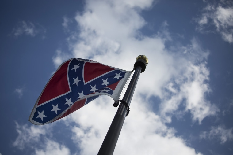 The Confederate flag is seen outside the South Carolina State House Building in Columbia, S.C., on June 23, 2015. (Photo by John Taggart/EPA)