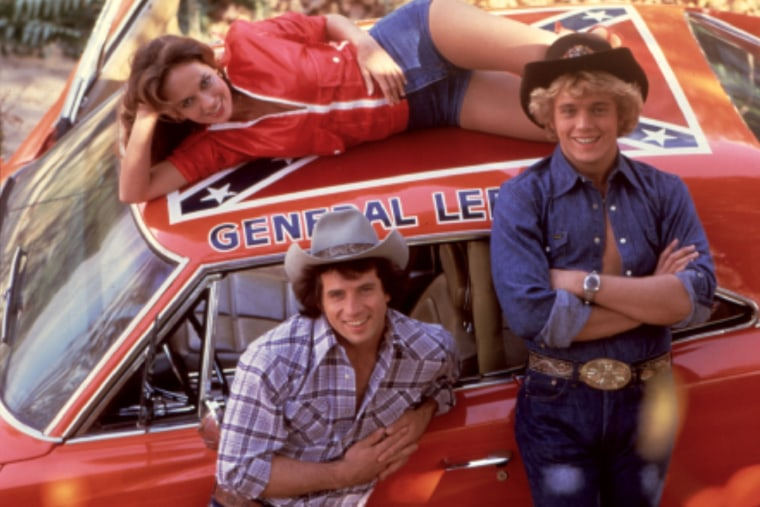 The Dukes Of Hazzard, Catherine Bach, Tom Wopat, John Schneider are seen with the famous General Lee car. (Photo by Moviestore Collection/Rex Features/AP)