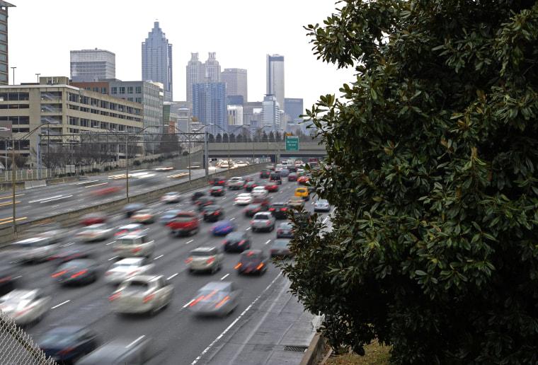 Traffic thickens on Interstate 75/85, Feb. 25, 2015, in Atlanta, Ga. (Photo by David Tulis/AP)