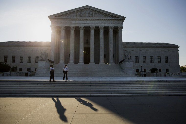 Police officers stand in front of the U.S. Supreme Court in Washington, D.C., June 22, 2015. (Photo by Drew Angerer/Bloomberg/Getty)