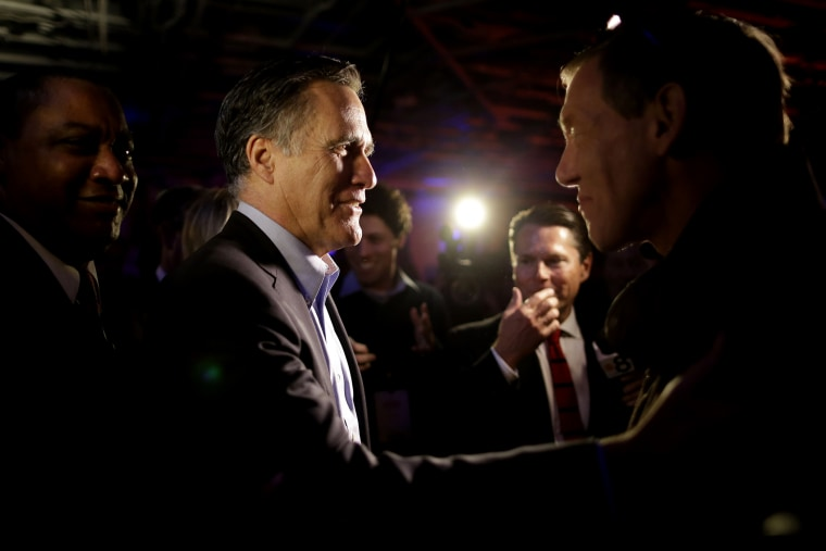 Mitt Romney, the former Republican presidential nominee, greets people after speaking during the Republican National Committee's winter meeting aboard the USS Midway Museum, Jan. 16, 2015, in San Diego. (Photo by Gregory Bull/AP)