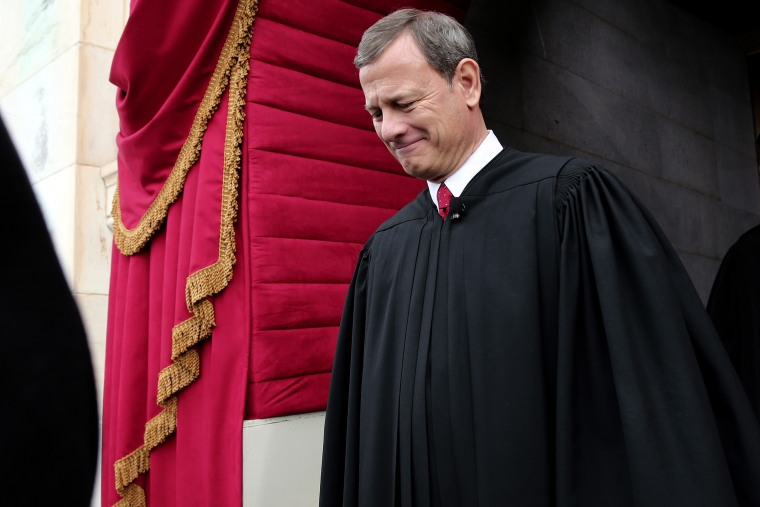U.S. Supreme Court Chief Justice John Roberts arriving at the West Front of the U.S. Capitol in Washington, where Roberts administered the oath of office to President Barack Obama, Jan. 21, 2015. (Photo by Win McNamee/AP)