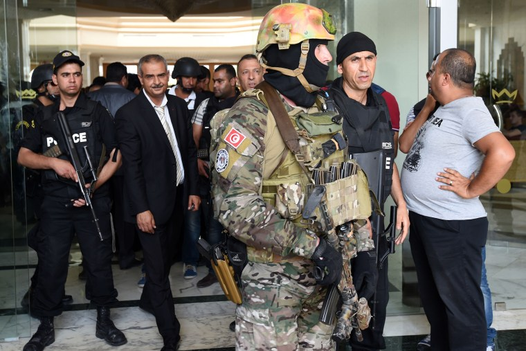 Tunisian security forces stand in front of the Imperial hotel in the resort town of Sousse, a popular tourist destination 140 kilometres (90 miles) south of the Tunisian capital, on June 26, 2015, following a shooting attack. (Fethi Belaid/AFP/Getty)