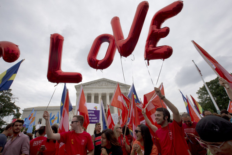 "Balloons spell out the word ""love"" over the Supreme Court in Washington on June 26, 2015, after the court declared that same-sex couples have a right to marry anywhere in the US."