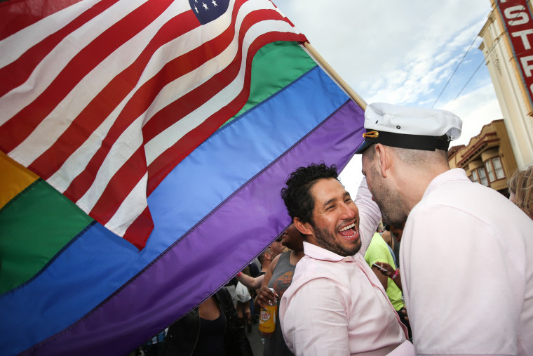Francisco Pavon and his friend Brandon McCarthy celebrate in front of San Francisco's iconic Castro Theater during gay pride weekend on June 27, 2015 in San Francisco, Calif. (Photo by Elijah Nouvelage/Getty)