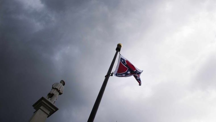 Storm clouds gather as pro-confederate flag demonstrators gather outside the S.C. State House in Columbia, S.C. on June 27, 2015. (Photo by Jim Watson/AFP/Getty)