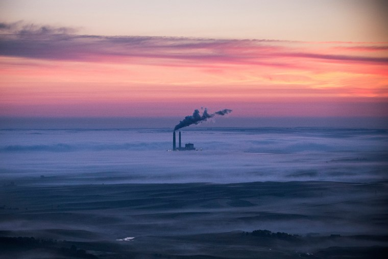 A coal-burning energy plant is seen in the early morning hours of July 30, 2013 near Bismarck, North Dakota. (Photo by Andrew Burton/Getty)