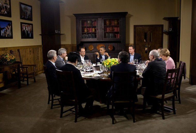 In this handout provided by The White House, President Barack Obama hosts a working dinner in Laurel Cabin during the G8 Summit on May 18, 2012 at Camp David, Maryland.