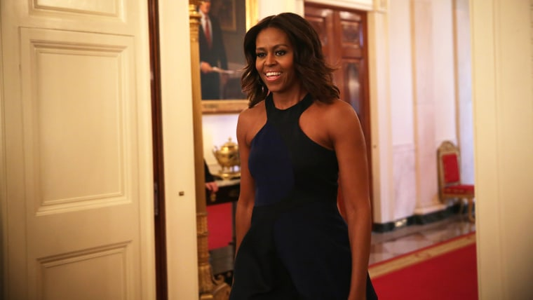 U.S. first lady Michelle Obama enters the East Room for a session of a Fashion Education Workshop at the White House on Oct. 8, 2014 in Washington, D.C. (Photo by Alex Wong/Getty)