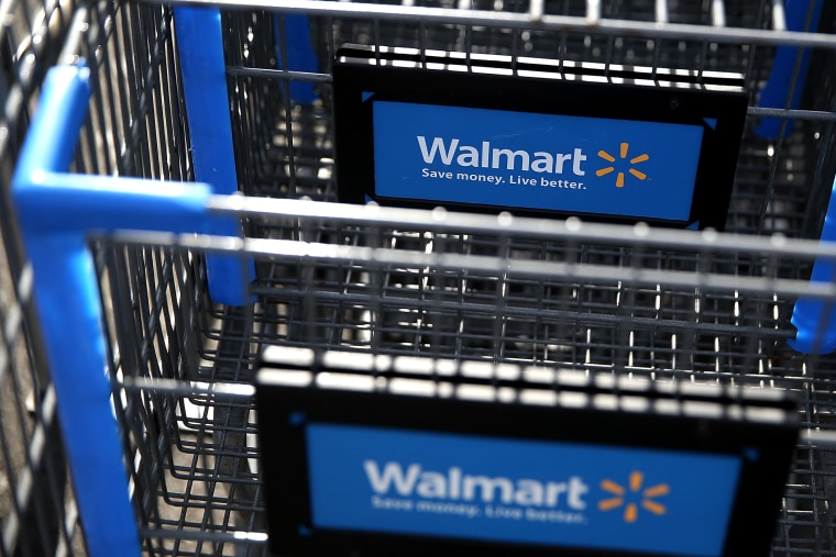 Wal-Mart shopping carts sit outside of a store. (Photo by Justin Sullivan/Getty)