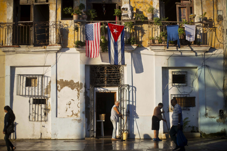 A U.S. and Cuban flag hang from the same balcony in Old Havana, Cuba, Dec. 19, 2014. (Photo by Ramon Espinosa/AP)