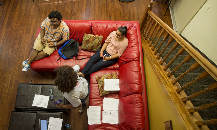 Dashari Kearse, 20, (Left) Maria Neris, 20, (Right) and Susan Ajayi, 21, (Foreground) talk inside the Institute of Black Culture Center in Gainesville, Fla. (Photo by Willie J. Allen Jr./Getty)