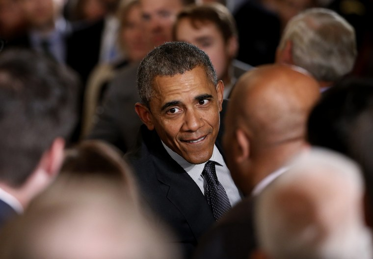 """U.S. President Barack Obama greets attendees in the crowd after signing House Resolution 2146, the """"Defending Public Safety Employees' Retirement Act and Trade Preference Extension Act of 2015,"""" June 29, 2015. (Photo by Jonathan Ernst/Reuters)"""