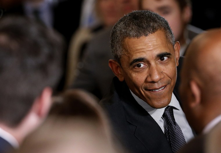 """U.S. President Barack Obama greets attendees in the crowd after signing House Resolution 2146, the \""""Defending Public Safety Employees' Retirement Act and Trade Preference Extension Act of 2015,\"""" June 29, 2015. (Photo by Jonathan Ernst/Reuters)"""