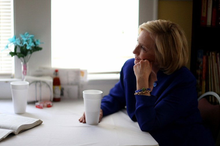 Democratic Presidential candidate Hillary Clinton sits with a customer as she visits the Main Street Bakery in Columbia, S.C. on May 27, 2015 (Photo by Joe Raedle/Getty).