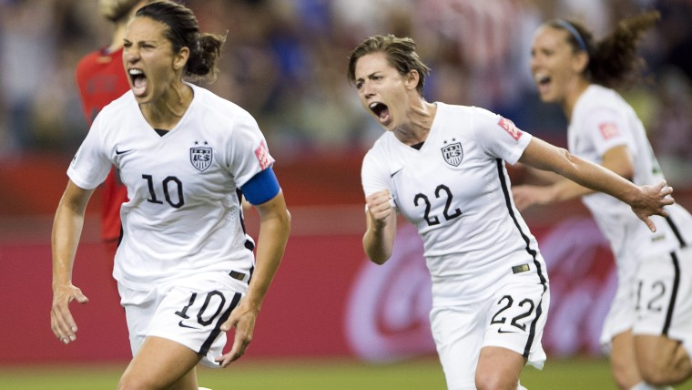 US team's Carli Lloyd (10) after scoring a penalty kick against Germany as Meghan Klingenberg (22) follows during a semifinal in the Women's World Cup soccer tournament, June 30, 2015, in Montreal, Canada. (Photo by Ryan Remiorz/The Canadian Press/AP)